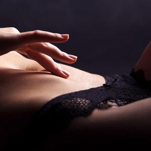 woman masturbating in bed
